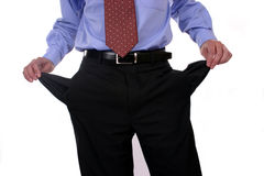 Empty pockets. Businessman meaning a bad situation, showing his empty pockets Royalty Free Stock Photo