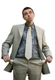 Empty pockets. Young business man showing his empty pockets looking up Royalty Free Stock Images