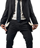 Empty Pockets. Business man with empty pockets, concept of failure, moneyless, white background Royalty Free Stock Image