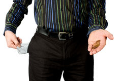 Empty pockets. Man shows empty pocket and little money isolated on white background royalty free stock photography