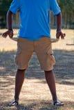 Empty pockets of a black boy Stock Image