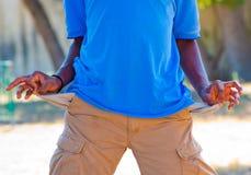 Empty pockets of a black boy Stock Photo