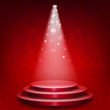 Empty podium illuminated lights. On red grunge background Royalty Free Stock Photography