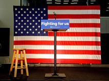 Empty Podium reads 'Fighting For US' at Hillary Clinton Rally at Royalty Free Stock Photos