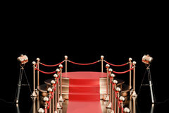 Empty podium with red carpet and barrier rope, 3D rendering. Isolated on black background Royalty Free Stock Photos