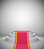 Empty podium with red carpet Stock Photography