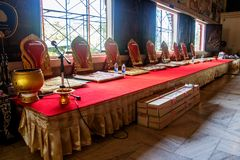 The empty podium with seats for a sittings monks Stock Photography