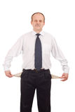 Empty pokets. Serious businessman shows his empty pockets-isolated on white stock photography