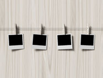 Empty polaroid photos frames on wood background Royalty Free Stock Photography