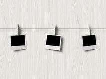 Empty polaroid photos frames on wood background Royalty Free Stock Image