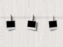 Empty polaroid photos frames on wood background Royalty Free Stock Image