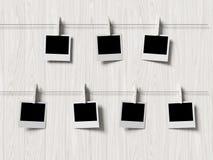 Empty polaroid photos frames on wood background Stock Images