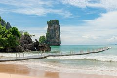 Empty pontoon bridge and a view of the rocks in the resort. Of Thailand Stock Photos