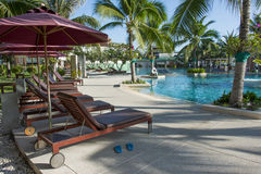 Empty pool bed along swimming pool Royalty Free Stock Image