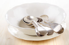 Empty porcelain bowl and spoon Stock Images