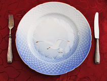Empty porcelain dish, silverware on damask-cloth. For an important dinner: damask, porcelain and silverware stock photo
