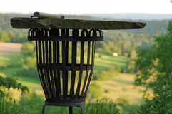 Empty portable BBQ grill in front of a fresh green summer landsc Stock Image
