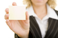 Empty Post-It. Frau holding an empty Post-It-Note royalty free stock image