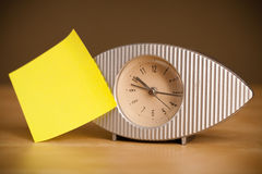 Empty post-it note sticked on alarm clock Stock Photography
