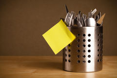 Empty post-it note sticked on cutlery case Royalty Free Stock Photography