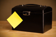 Empty post-it note sticked on jewelry box Stock Image