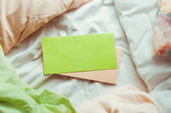 Empty postal envelopes on a bed Royalty Free Stock Photography