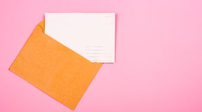 Empty postcard and envelope stock image