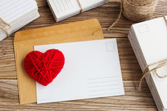 Empty postcard, postcrossing, Red heart love letter royalty free stock image