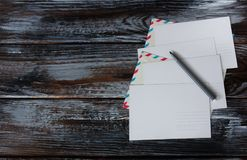 Postcards and envelopes on wooden back. Empty postcards and envelopes on wooden back Stock Photography