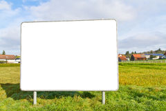 Empty poster on a meadow Stock Image