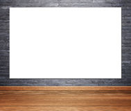 Empty poster in room interior with brick wall and wood floor bac. Empty white poster in room interior with brick wall and wood floor background Royalty Free Stock Photography