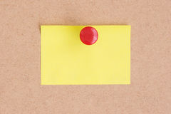 Empty postit on cork board. Empty yellow postit on cork board Stock Photo