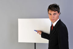 Empty presentation. Man in suit, white empty presentation board Stock Images