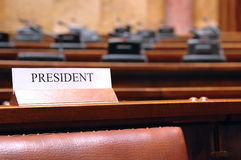 Empty president seat in conference hall Stock Photography