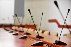 Empty press conference romm with microphones Royalty Free Stock Photography