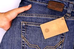 Empty price tag with jeans Royalty Free Stock Photo