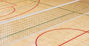 Empty professional volleyball court . Team sport. Elementary school gym indoor with volleyball net stock photos