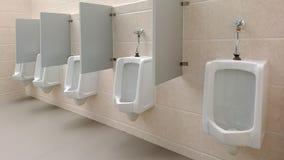 Empty public men toilet. In shopping mall Stock Photos