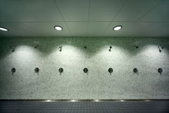 Empty public shower room Stock Photos