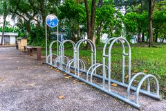 Bicycle parking in the park. Empty public steel bicycle parking in the park Stock Image