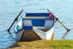Empty punt boat at lake`s shore.  Royalty Free Stock Photo