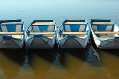 Empty punt boats at a pier Stock Image