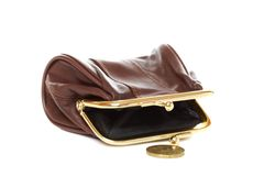 Empty purse and coin on a white background. Stock Photos