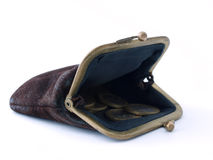 An empty purse with some coins on a white backgrou. Old leather purse with a few metal coins on a white background royalty free stock images