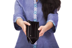 Empty purse in women`s hands; no money. On a white background Royalty Free Stock Images