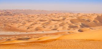 Empty Quarter Desert Convoy. A convoy in the Rub al Khali or Empty Quarter. Straddling Oman, Saudi Arabia, the UAE and Yemen, this is the largest sand desert in stock images