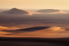 Empty quarter desert. Golden sands of empty quarter desert, Oman Royalty Free Stock Image