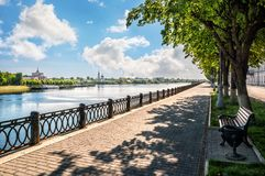 Empty quay in Tver. The empty embankment of the Volga River in Tver and a view of the Catherine Monastery and the River Station with a boat royalty free stock photo