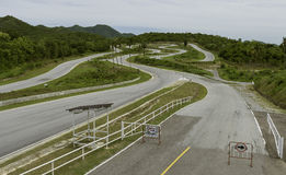 Empty racing track for motor bike in the mountain Stock Photo