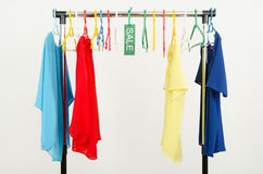 Almost empty rack of clothes and hangers after a big sale. Royalty Free Stock Images